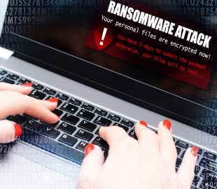 Ransomware virus attack message blocking a user to access data on computer